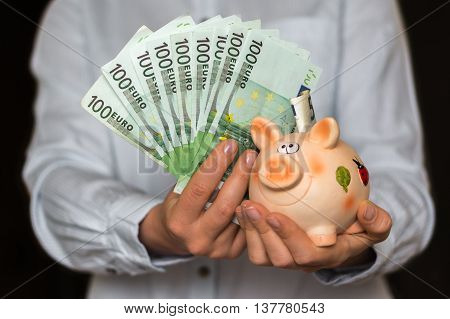 Young Woman With Piggy Bank And Euro Money Banknotes
