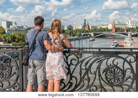 Romantic Couple Of Tourists In Moscow Look At The Kremlin