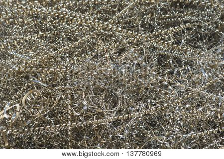 metal industrial mill drill shavings textured background macro shallow depth of field