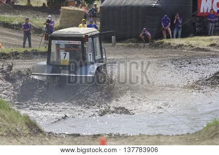 Rostov-on-Don Russia- June 052016: Competition for agricultural tractors on the Bizon Track Show.Tractor overcome the water barrier. Press pictures of the race