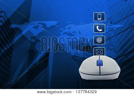 Wireless computer mouse with telephone mobile phone at and email buttons over map and city tower background Customer support concept Elements of this image furnished by NASA