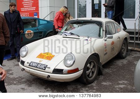 PERM RUSSIA - JUNE 29 2016: Rally of retro-cars Peking-Paris 2016 June 29 2016 in Perm Russia. White Porsche 911 is in the city after the next stage.
