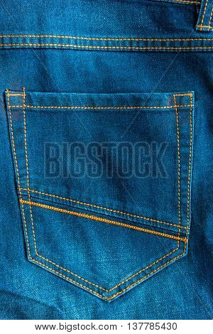 back pocket of blue jeans close up