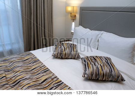 Nice bedroom with the big bed close-up