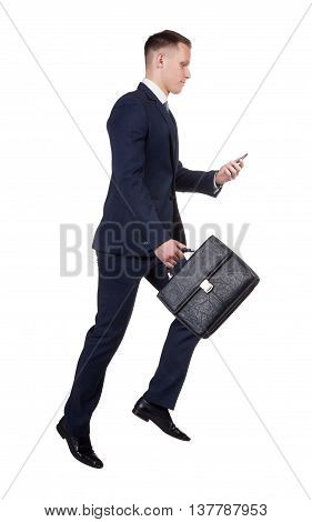 side view of hurrying businessman with his briefcase trying to call by the smart phone on white background