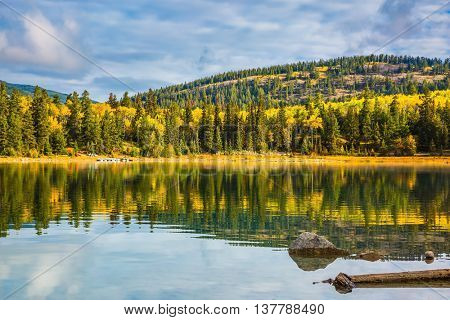 Autumn in Jasper Park, Canadian Rockies. Charming Patricia Lake amongst the evergreen forests, yellow bushes and mountains