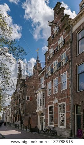 street with historical houses in Delft city center Netherlands