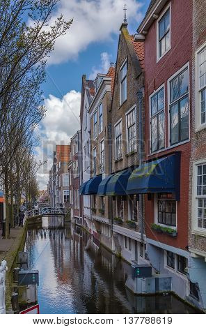 view of houses along the canal in Delft Netherlands