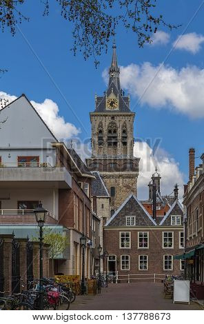 view of street with church in Delft city center Netherlands
