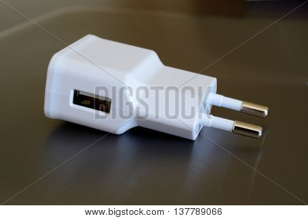 White electric plug with USB socket closeup.