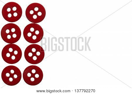 Few red studs on white background with copy space