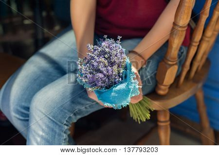 Bouquet in the hands of girl. Lavender flower