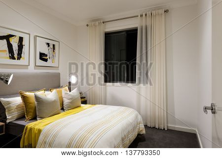Classic Bedroom Of A Modern House With Table Lamps On