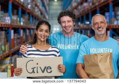 Portrait of happy volunteer are posing face to the camera in a warehouse