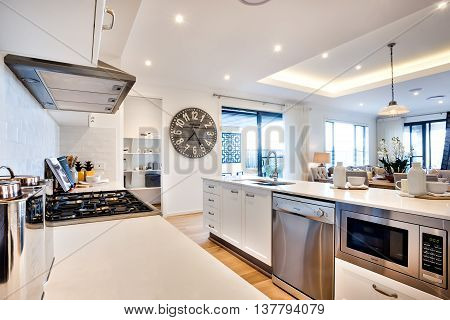 Modern Kitchenware Including A Stove And Ovens With Big Watch