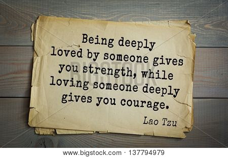 Ancient chinese philosopher Lao Tzu quote on old paper background. Being deeply loved by someone gives you strength, while loving someone deeply gives you courage.