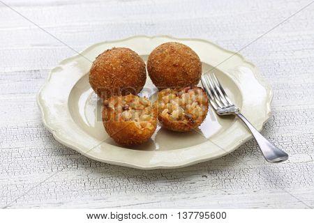 arancini di riso, fried risotto rice balls, italian sicilian food