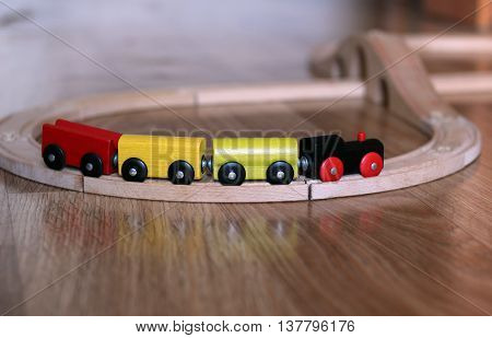 Train toy. Wooden colored transport.