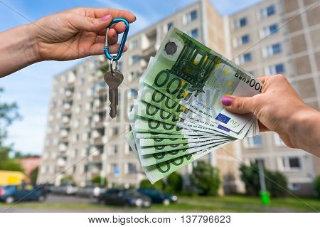 Real Estate Agent Giving Apartment Keys To A New Property Owner,