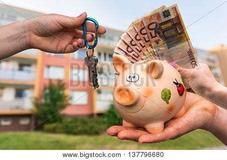 Real Estate Agent Giving Flat Keys To A New Property Owner, Who