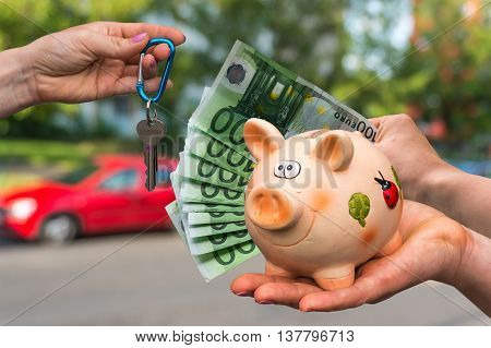 Salesman Giving Car Key To A New Car Owner, Who Is Paying Last S