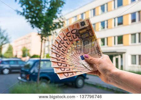 Property Buyer Holding Euro Banknotes And Buying Beautiful Flat