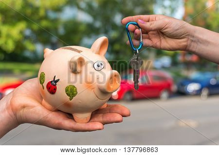 Salesman Giving Car Keys To A New Car Owner, Who Is Paying All S