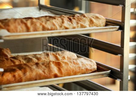 Strudels on shelving in bakery
