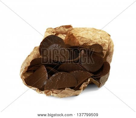 Chocolate chips in parchment on white background