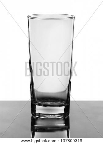 Empty glass on light background