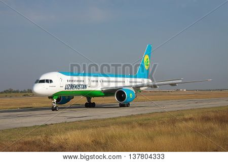 Simferopol Ukraine - September 13 2010: Uzbekistan Airways Bowing 757-200 is taxiing along the taxiway in the airport