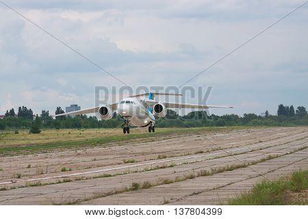 Kiev Ukraine - August 3 2011: Antonov An-148 regional passenger jet plane is taking off from the manufacturer's runway