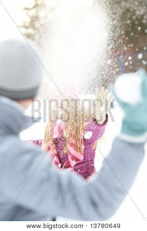 Image of attractive young woman flinging the snowball and having fun