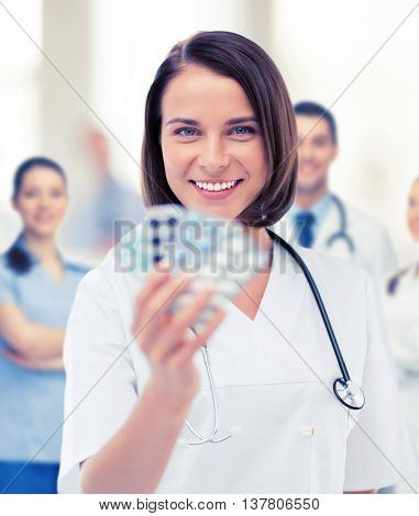 healthcare and medical concept - doctor with blister packs of pills