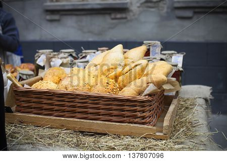 White french bread in the basket on the street market