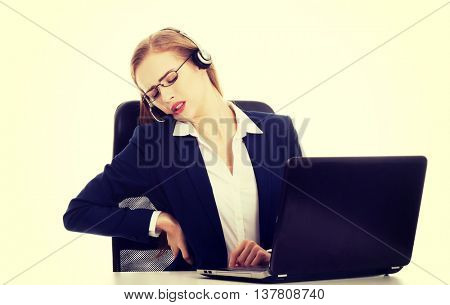 Business woman at call center is having backache