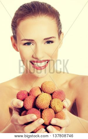 Beautiful woman holding fist of lychee.