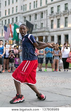 New York City NY USA - September 15 2014. A young boy breakdancing in Grand Army Plaza, Manhattan, New York City.