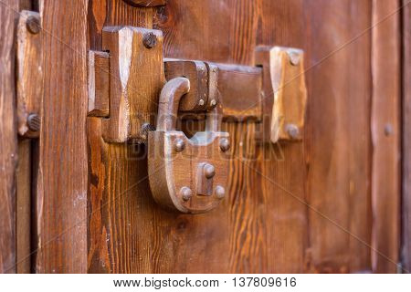 padlock wood weighs on a wooden door