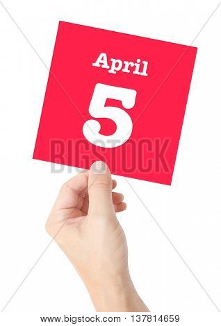 April 5 written on a card held by a hand