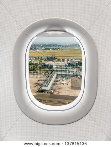 Looking Out The Window Of A Plane To The Airport In Prague