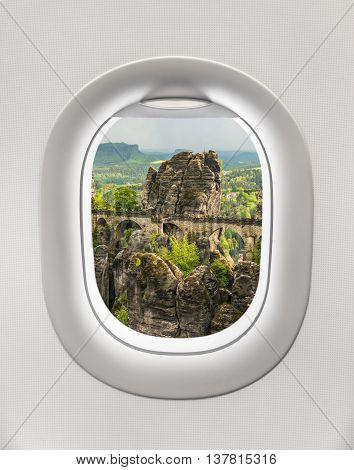 Looking Out The Window Of A Plane To The Bastei Bridge