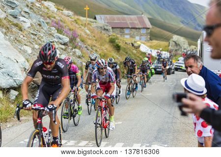 Col de la Croix de Fer France - 25 July 2015: The Portuguese cyclist Tiago Machado of Team Katusha riding in the peloton in a rocky natural environment at Col de la Croix de Fer in Alps during the stage 20 of Le Tour de France 2015.