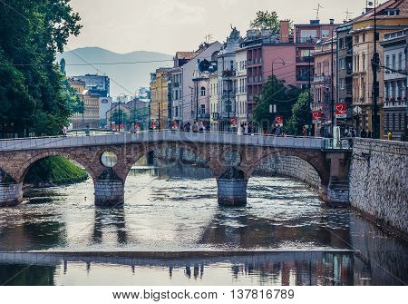 Sarajevo Bosnia and Herzegovina - August 23 2015. People walks on Latin Bridge over Miljacka river in Sarajevo