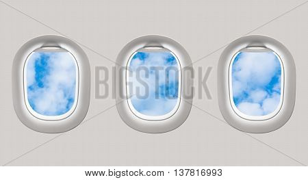 Looking Out The Windows Of A Plane To The Blue Sky And Clouds