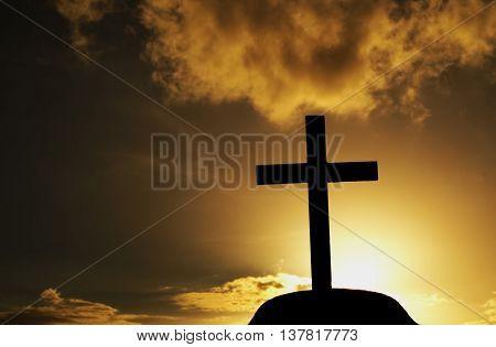 black cross at grave when sunset light