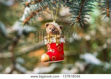 Teddy Bear In Christmas Sock On Snowy Branch Fir