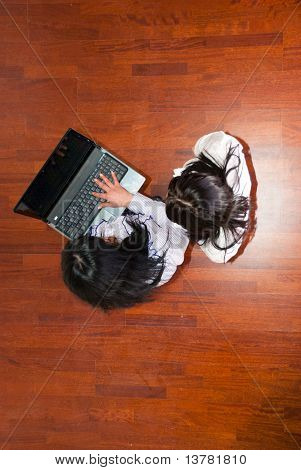 Top View Of Business Women Using Laptop