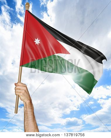 Person's hand holding the Jordanian national flag and waving it in the sky, 3D rendering