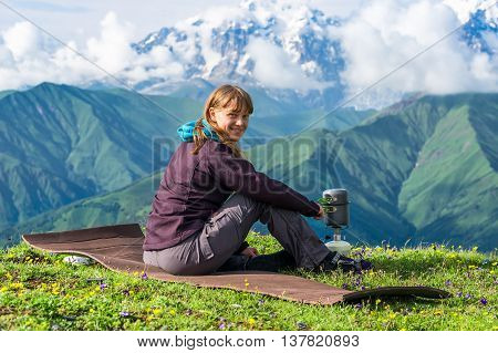 Young Lady Hiker Preparing Something To Eat